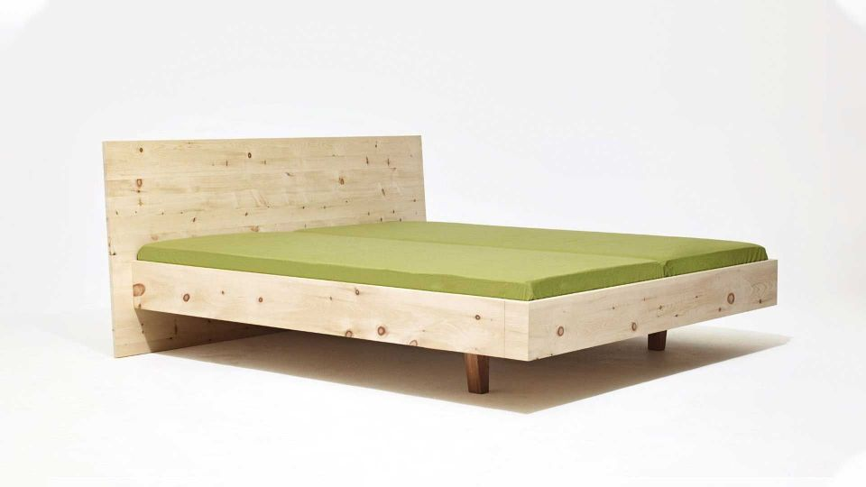 Bed Anna Wood; Bedstead on floating base; Wood type Swiss pine|Bed Anna Wood - Bedstead with headboard made of Swiss pine wood.